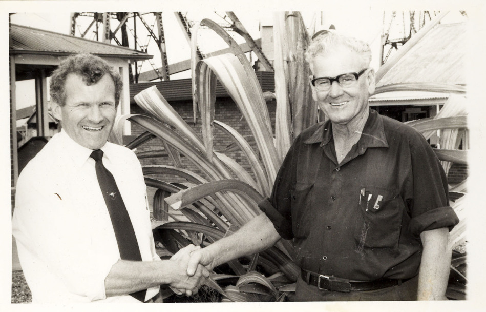 John Darling Colliery, Belmont, Lake Macquarie, NSW. Dave McDonald on his retirement shaking hands with the Manager Bruce McKensey (L)