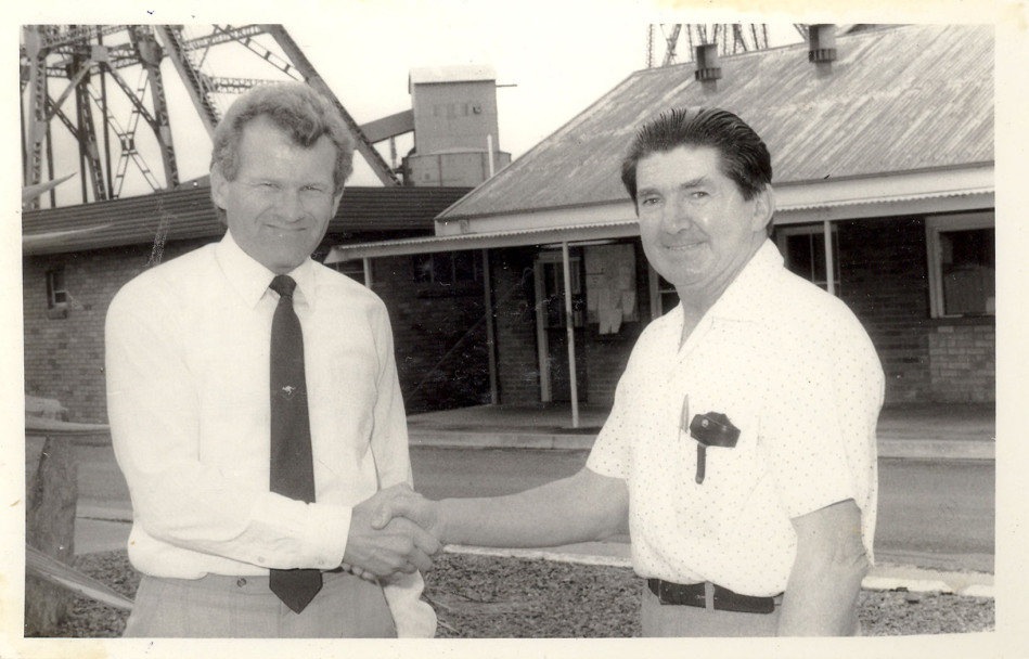 John Darling Colliery, Belmont, Lake Macquarie, NSW. Gold watch retiree Bill Coull (storeman) is farewelled by manager Bruce McKensey (L).