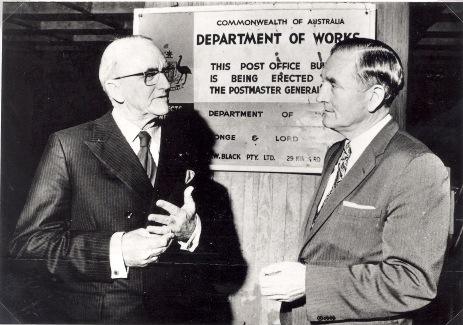 Councillor A. Pickering and Senator John Carrick at the construction site of new Post Office, Charlestown