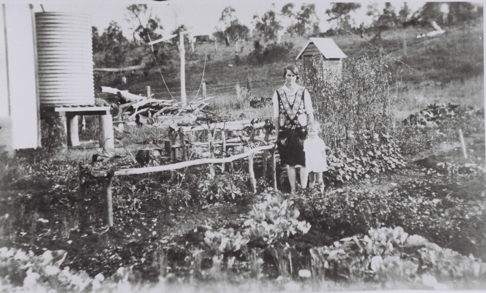 Alice Christensen and her daughter Norma in the garden of Lot 485 Ilford Avenue Arcadia Vale during the Depression in 1929.
